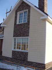 Облицовка фасадов зданий сайдингом или кирпичом.